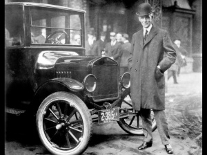 While other auto makers wanted to design luxury cars, Henry Ford designed a car that anyone could afford. Here he is standing by that very car. From the collections of The Henry Ford and Ford Motor Company.