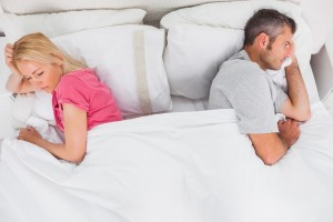 couple-in-bed-not-talking-300x200